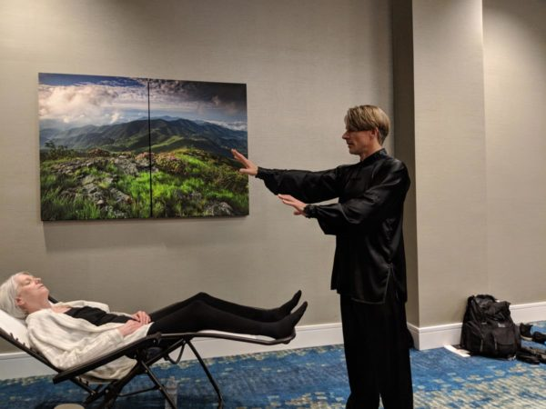 David J Coon is pictured here giving a workshop participant a Medical Qigong Treatment